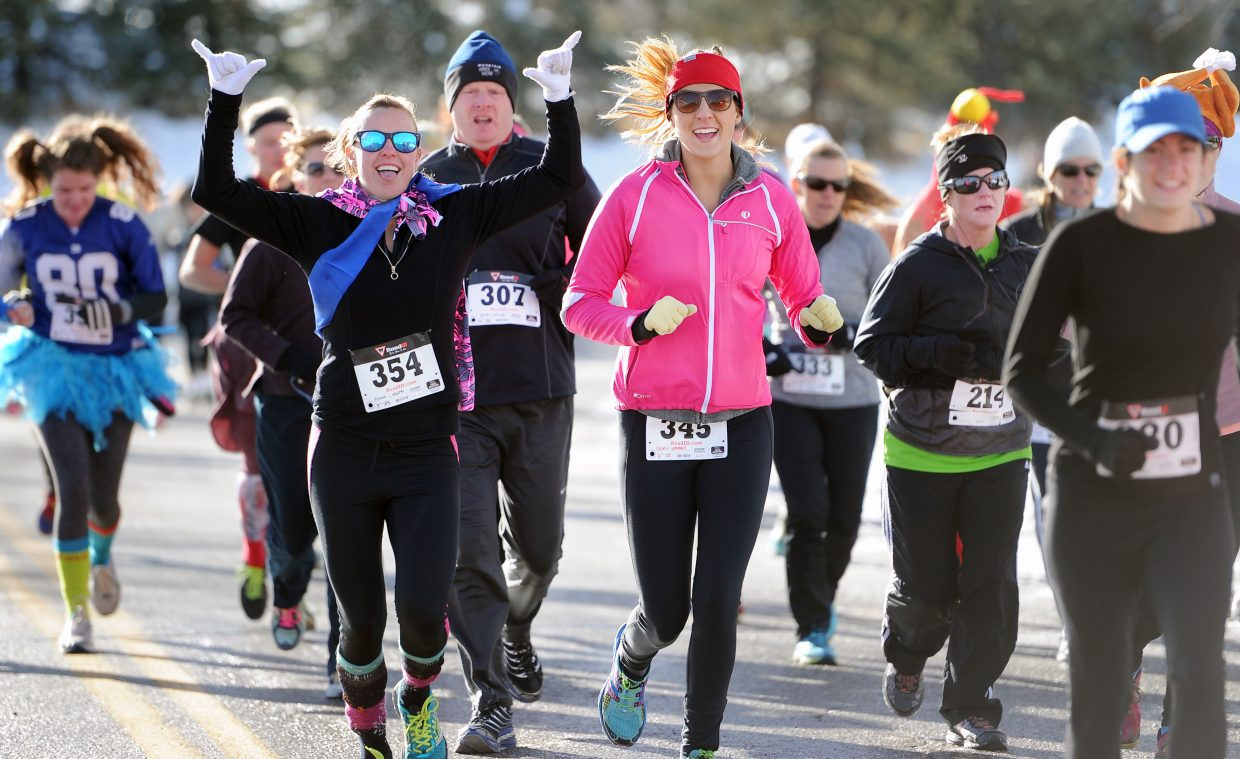 Kate Hunt throws up some hang loose hand gestures mid-race at the 2014 Steamboat Springs Turkey Trot.