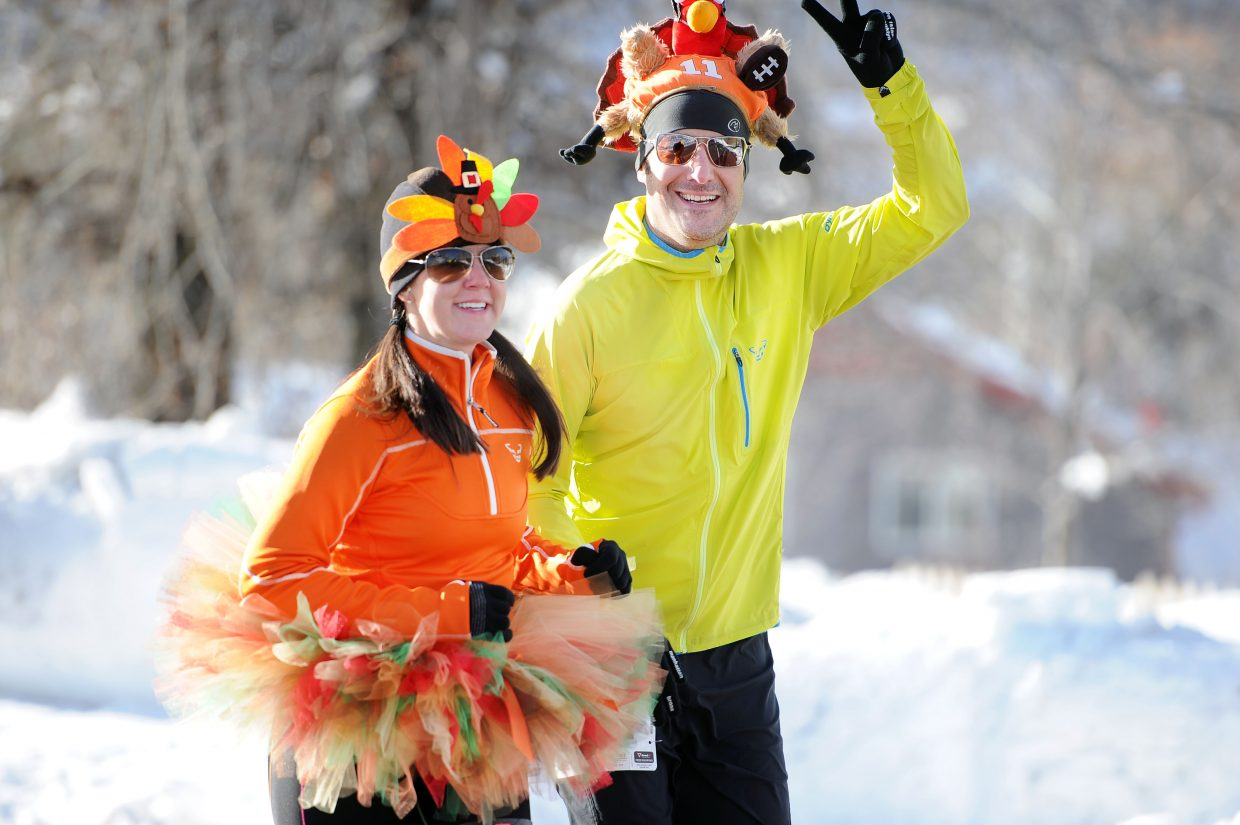 Chris and Jessica Sword trotted through the 2014 Steamboat Springs Turkey Trot in some very traditional attire.