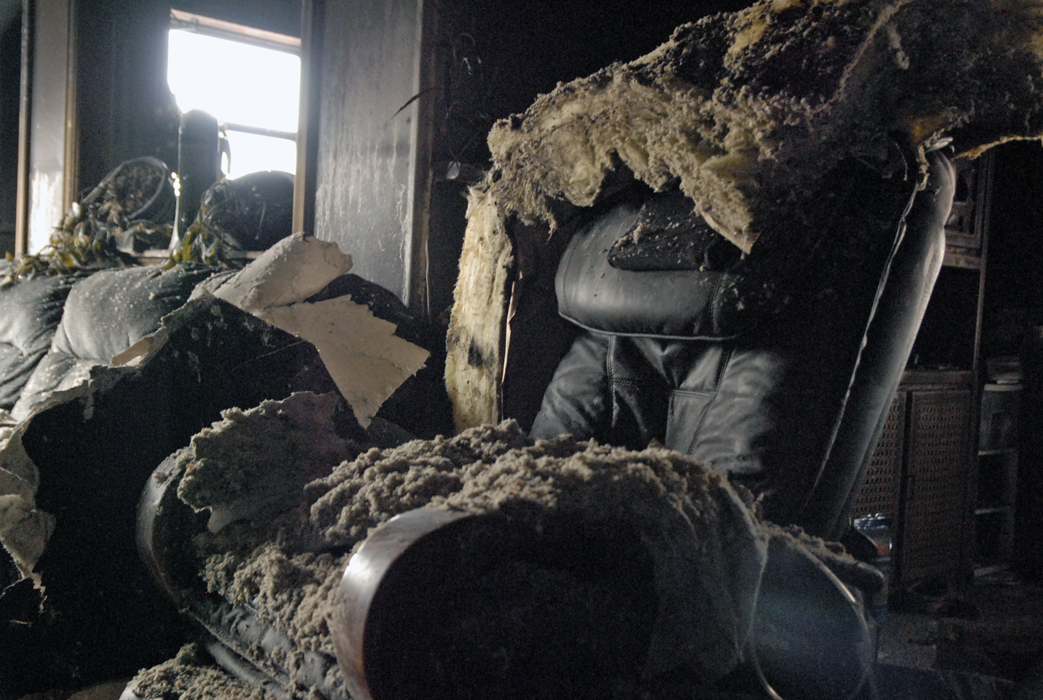 A recliner sits in the aftermath of a Tuesday night home fire in Craig.