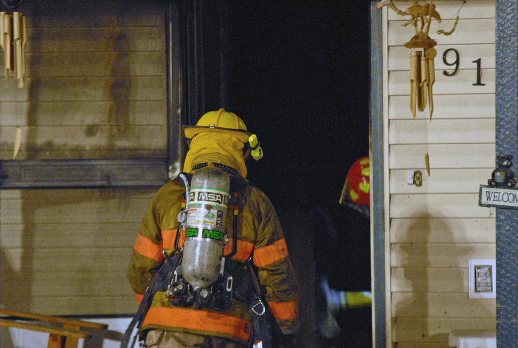A second wave of firefighters enters a home fire Tuesday at 1912 Woodland Ave. in Craig.