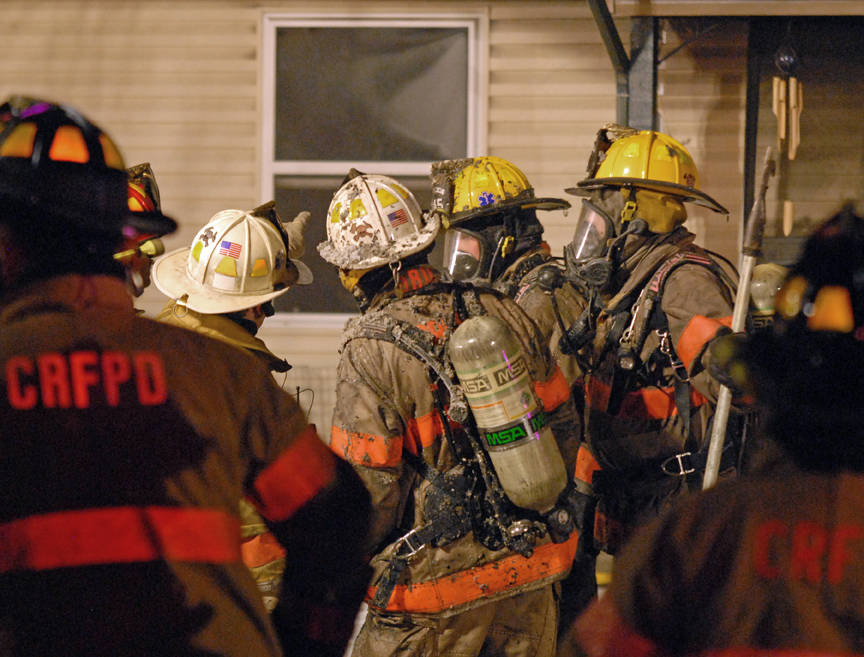 Craig firefighters evaluate the progress of suppression activities and evaluate where next to fight the blaze during a home fire Tuesday night.