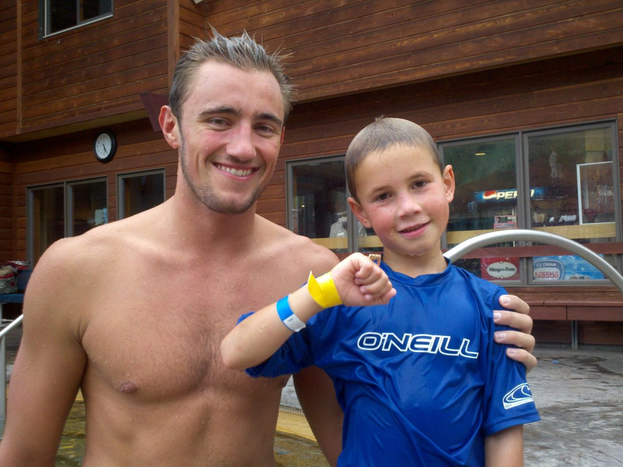 Olympic swimmer Blake Worsley shares his Olympic ring with Rowan Turek at the Old Town Hot Springs. Submitted by: Norbert Turek