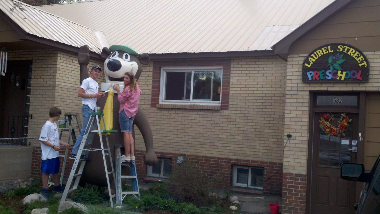 Heather Martin, with her sons Ryan and Andrew Sabia, give Yogi a makeover at Laurel Street Preschool. Submitted by: Norbert Turek