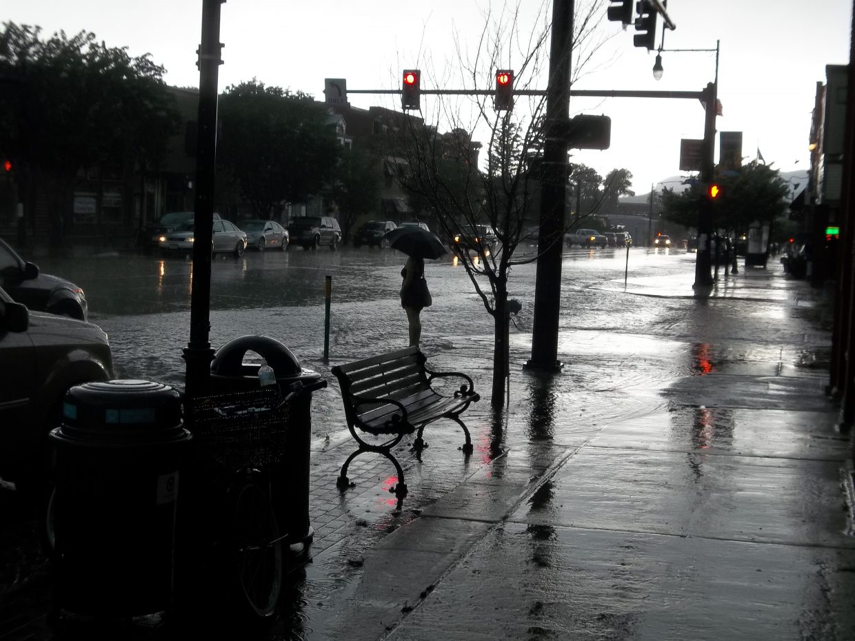 Woman at Ninth Street and Lincoln Avenue deep in water. Submitted by: Bill Dorr