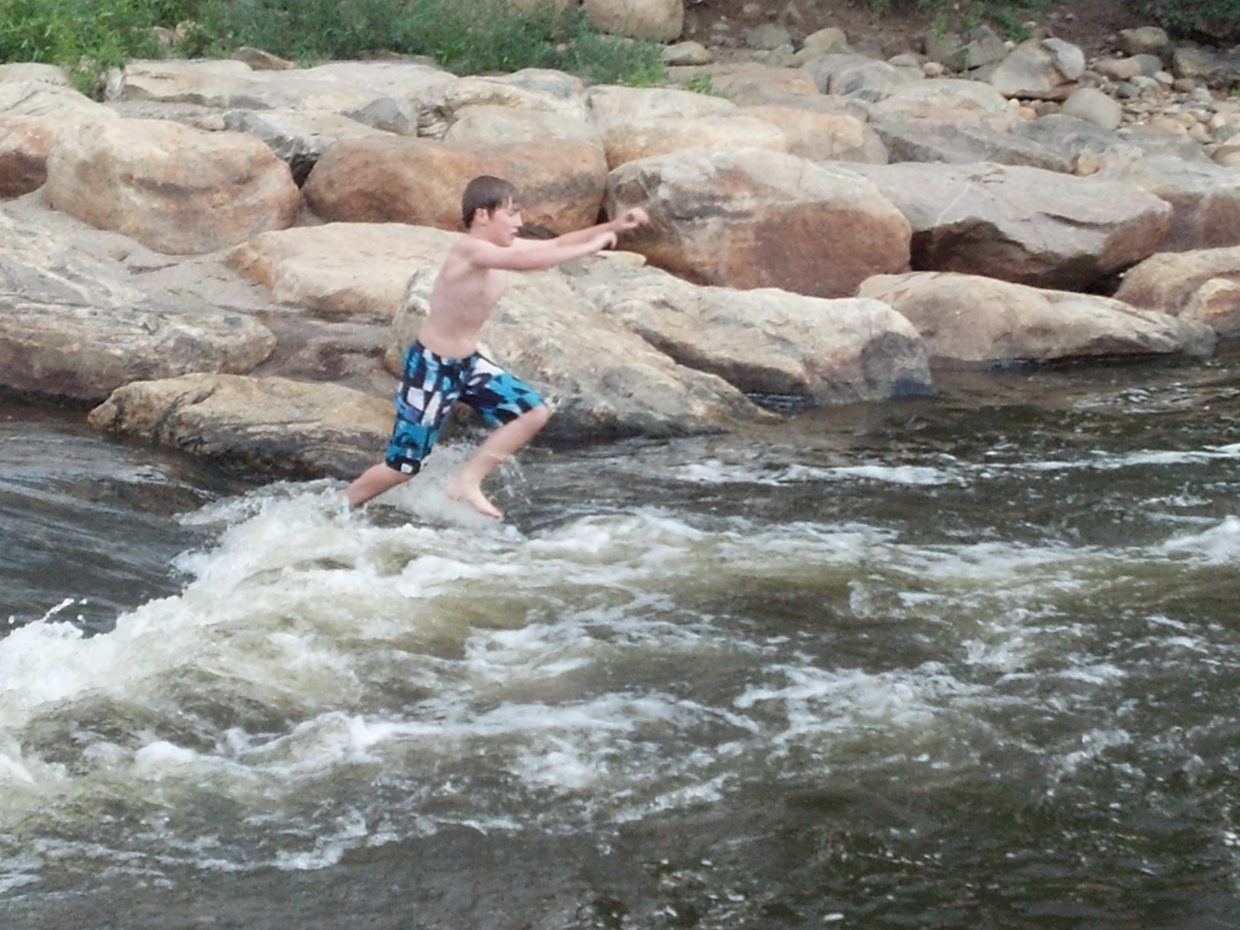 Mason Homan, Davis Homan, Willie Martin and Ethan Spence playing in the Yampa River. Submitted by: Randy Homan