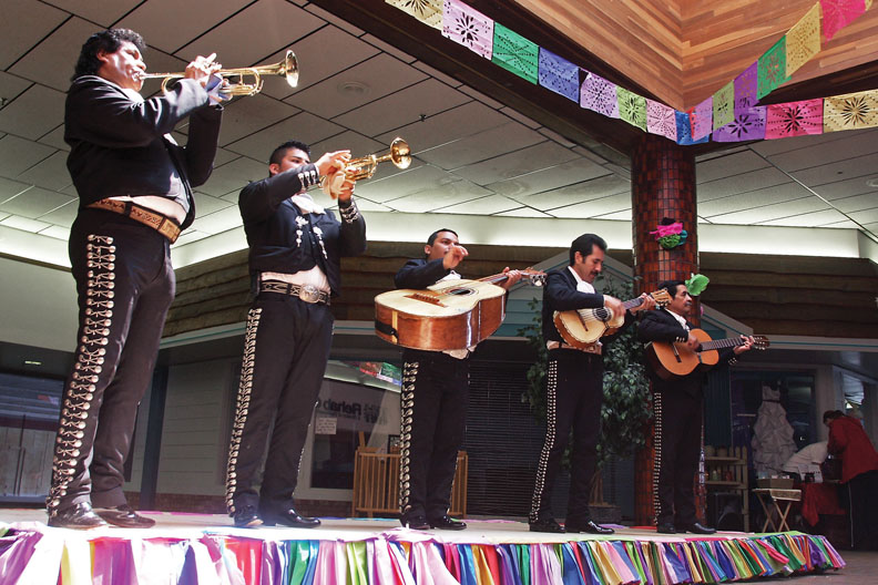 Mariachi members of the group Alma de America perform during the sixth annual Cinco de Mayo celebration Saturday at Centennial Mall. Integrated Community brought the group into town from Glenwood Springs for the event.