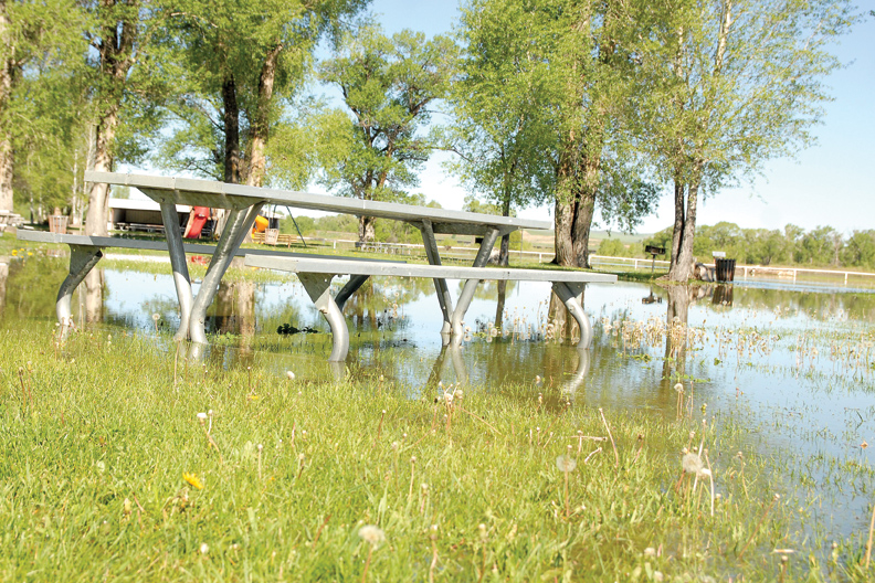 A picnic area on the north side of Loudy-Simpson Park is flooded by water from the Yampa River.