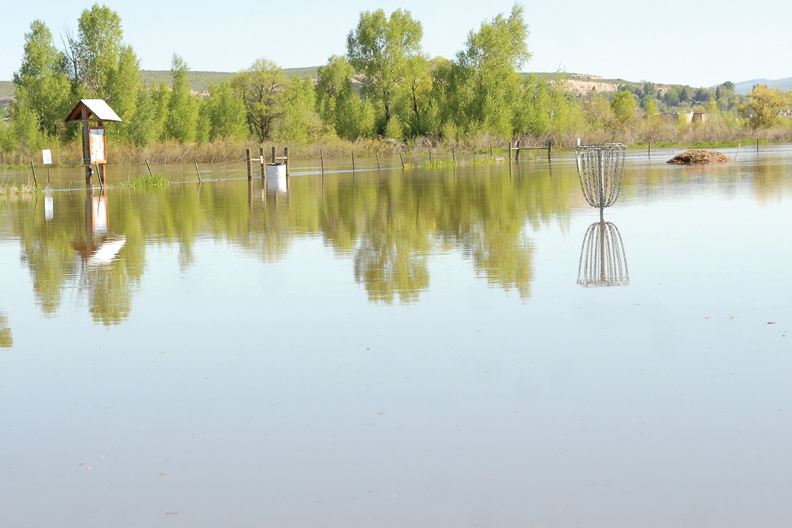The disc golf course at Loudy-Simpson Park has been flooded by rising water from the Yampa River.