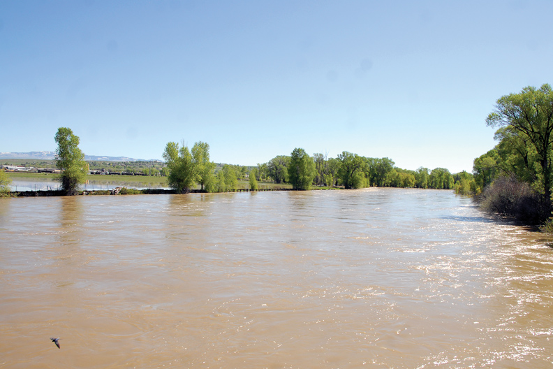 The Yampa River, pictured here off Ranney Street, has flooded over into Loudy-Simpson Park, Yampa Valley Golf Course and other areas.