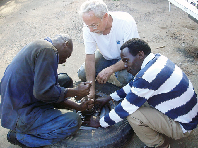 Former Craig resident Harvey Craft replaces a wheel bearing with fellow workers at the Marion Medical Mission Shallow Well Program in Malawi, Africa. Craft spent six weeks in Malawi last year providing maintenance to the program's truck fleet and installing water well pumps throughout the country. He will give a slideshow presentation at 6 p.m. Sunday at Calvary Baptist Church, 1050 Yampa Avenue.