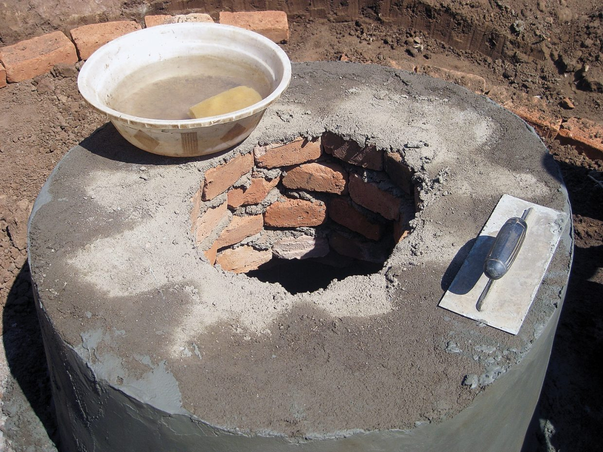 An in-progress drinking well in Malawi, Africa, shows the work of Marion Medical Mission Shallow Well Program. The project is a combined effort between Malawi residents and volunteers from the mission. Here, the well is being capped with concrete.