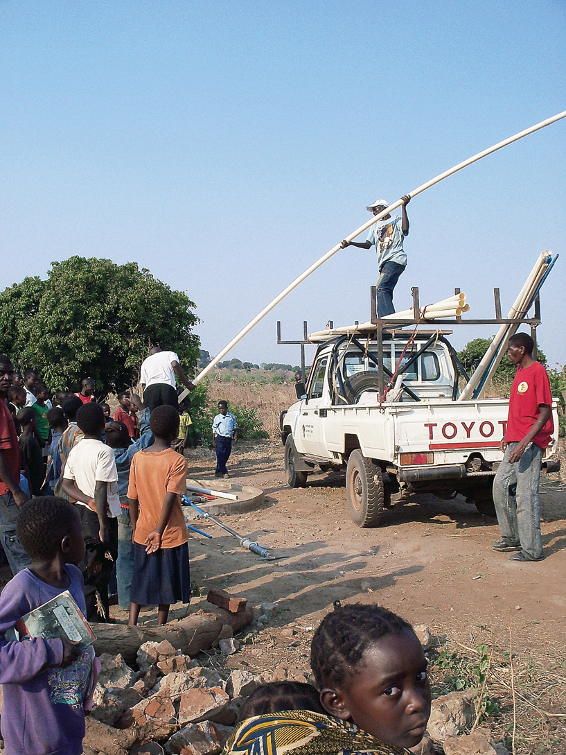 A worker with the Marion Medical Mission Shallow Well Program in Malawi, Africa, stands atop a truck and prepares to insert a PVC pipe into a village well. Former Craig resident Harvey Craft spent 6 weeks in Malawi last year helping with the well project. Craft will give a slideshow presentation at 6 p.m. Sunday at Calvary Baptist Church, 1050 Yampa Avenue.