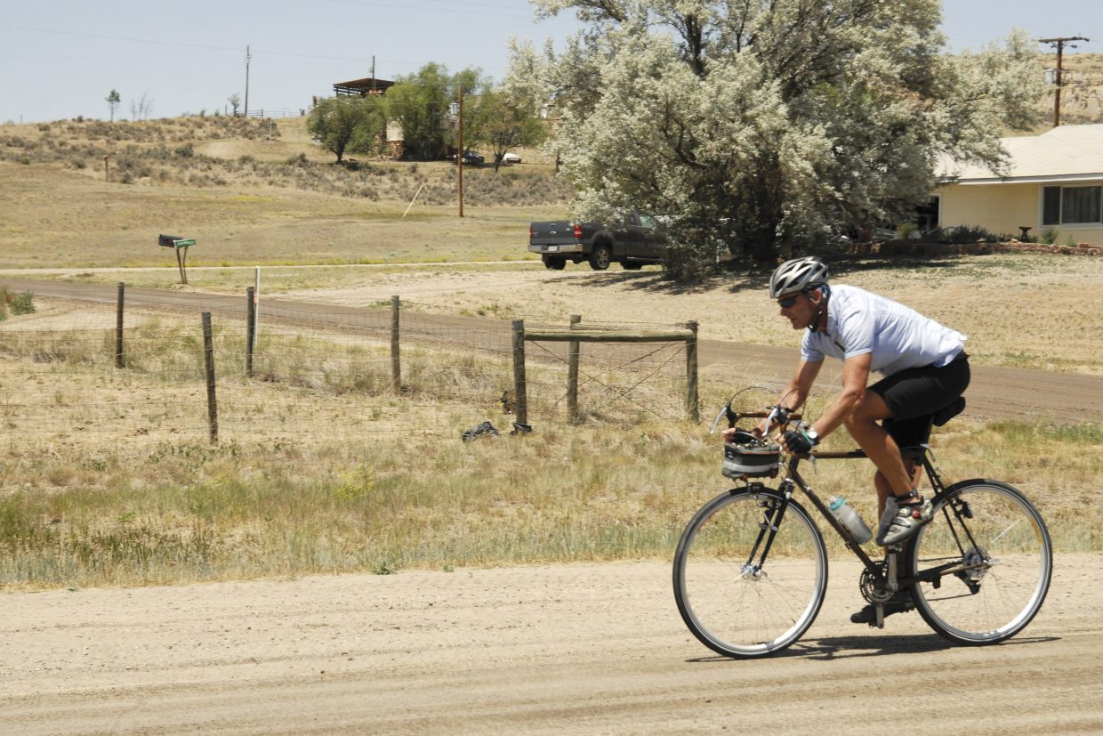 A cyclist bikes down Colorado Highway 13 on his way to Craig during the fourth leg of the Bicycle Tour of Colorado. More than 1,200 cyclists rode for 111 miles Tuesday from Saratoga, Wyo., to Craig. The tour is in its 18th year and stopped in Craig for the first time, with a stop scheduled Wednesday in Steamboat springs.