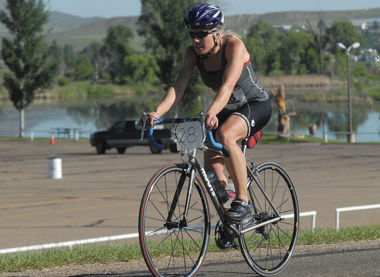 Carri Wullner finishes the 5K race on the cross country course and begins her 30K bike ride on Sunday.