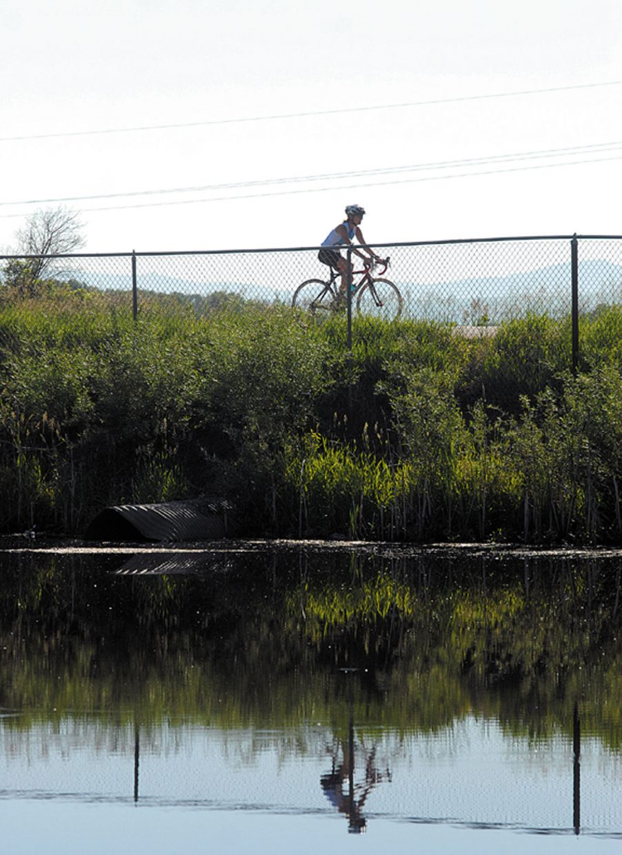 A rider makes her way past the pond at Loudy-Simpson Park during Sunday's Craig Duathlon. More than 30 riders and runners participated in the event, which is part of the Steamboat Springs Running Series.