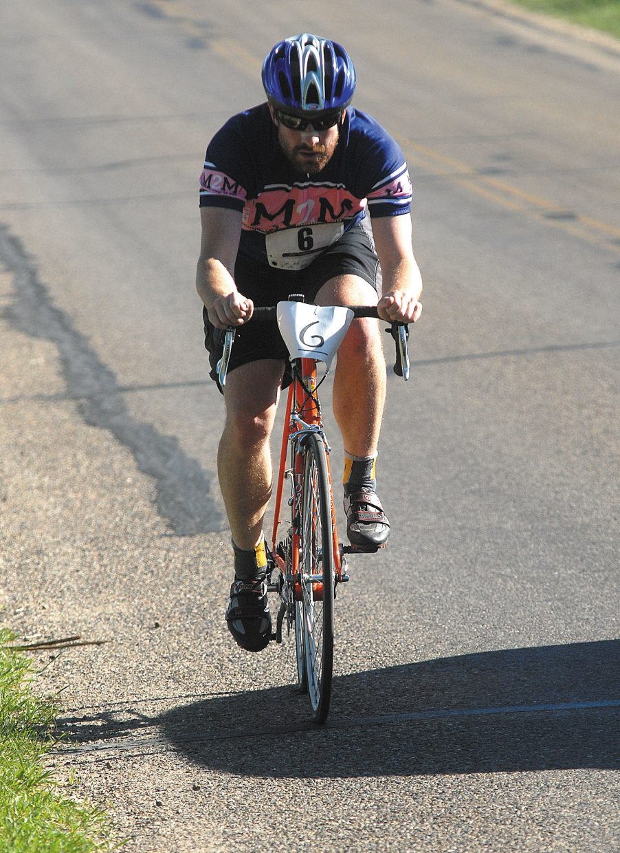 Matt Hall bikes up the hill on Ranney Street near Loudy-Simpson Park during the Craig Duathlon. More than 30 runners and riders participated in the event.