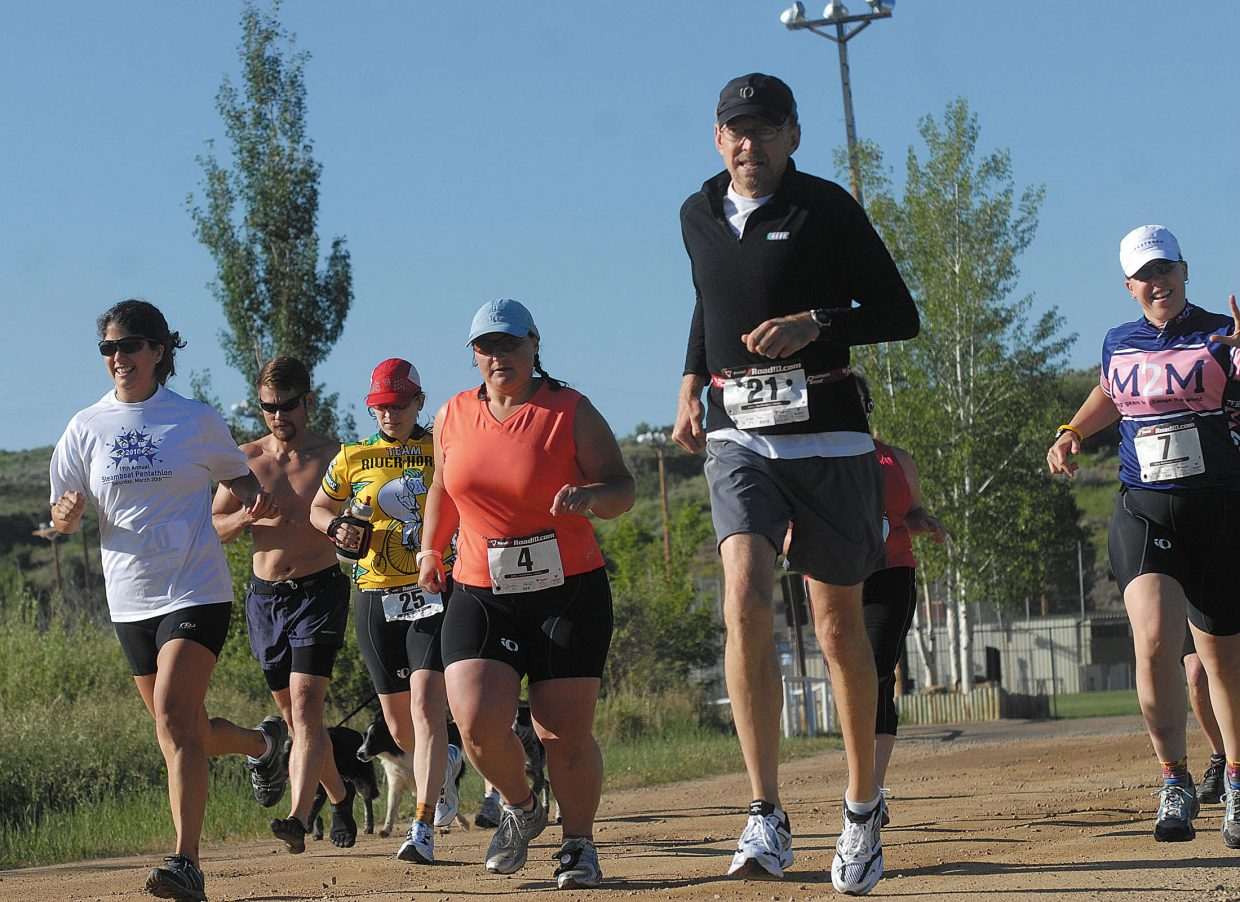 Runners take off following the start of the first Craig Duathlon on Sunday morning.