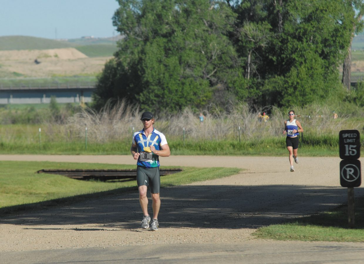Tim Hanna finishes the second lap of the first 5K run at Loudy-Simpson Park.
