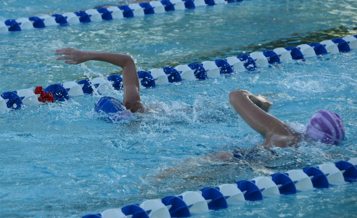 Kelsey, left and Jaci McDiffet go through their morning workout Thursday to prepare for their home meet at the Craig Swimming Complex. The Craig Sea Sharks youth swimming team will host the ABC Meet on Friday through Sunday.