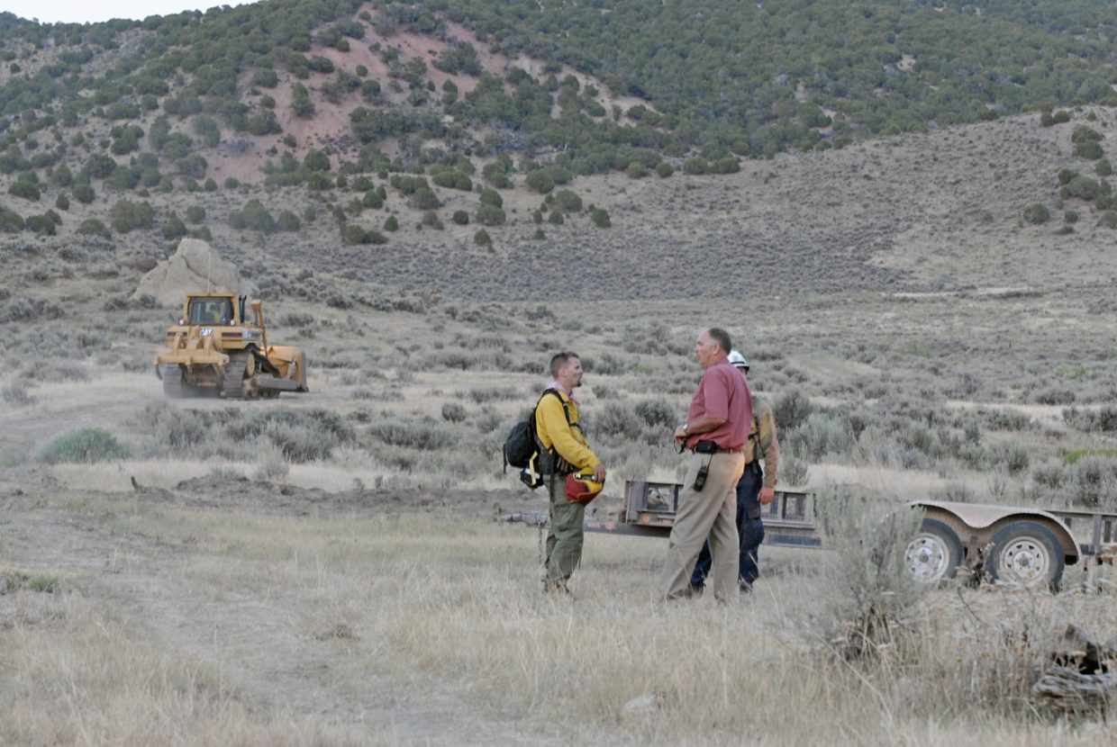 Moffat County Sheriff Tim Jantz arrives Tuesday at the scene of the Cedar Knob Fire located on Pete Shelton's property about 20 miles south of Maybell. Employees with the Moffat County road and bridge department deployed bulldozers to the scene to construct a fire line around Shelton's structures.