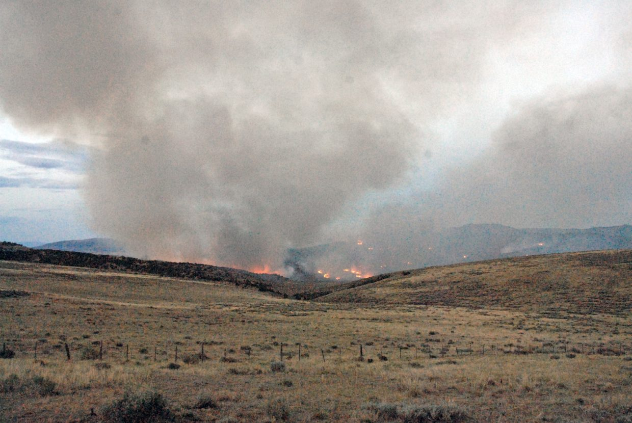 The Cedar Knob Fire burns on private land Tuesday in Moffat County about 20 miles south of Maybell. Fire officials were unable to estimate the size of the blaze Tuesday.