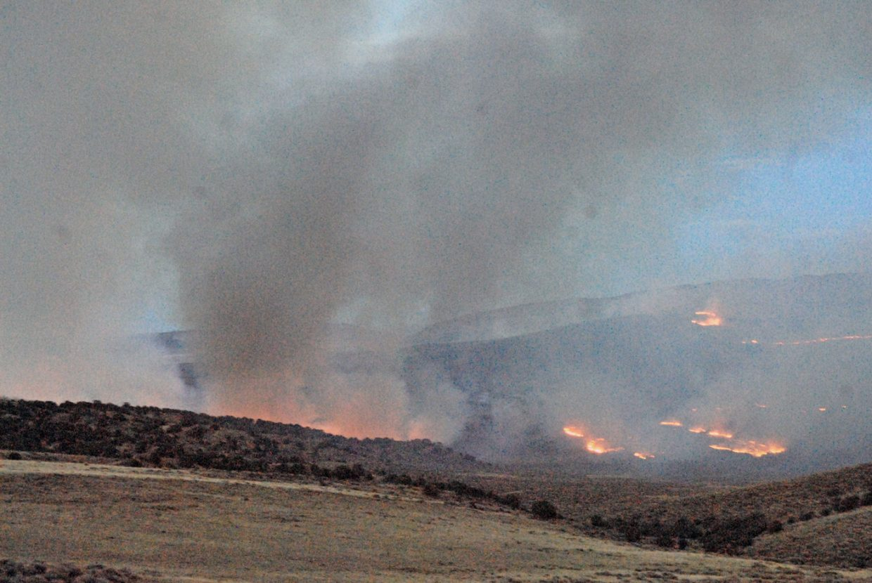 The Cedar Knob Fire burns on private land Tuesday in Moffat County about 20 miles south of Maybell.
