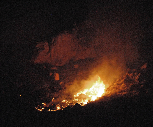"""The Cedar Knob Fire """"runs"""" up the east slope of a hill Tuesday night."""