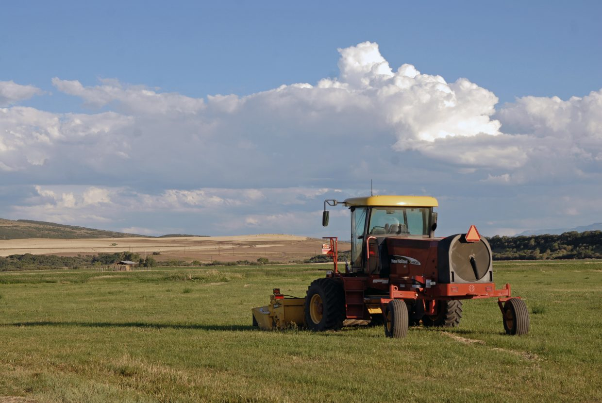 A swather sits idle at Carpenter Ranch in Hayden. The brown meadows in the background are a common sight for Yampa Valley residents during one of the worst drought years in memory for agricultural producers.