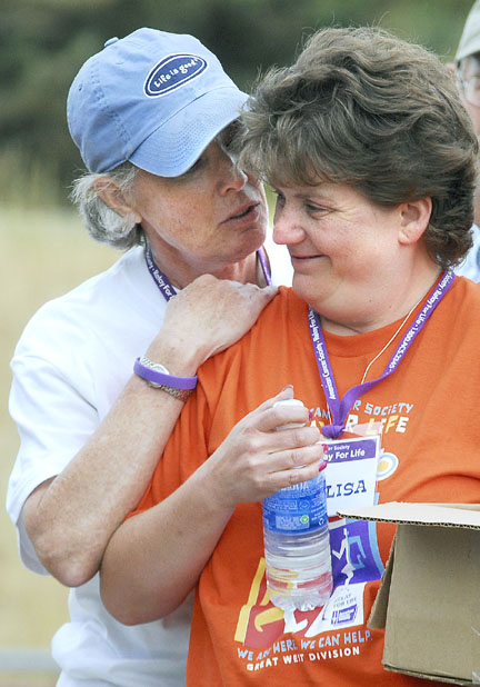 Anne Gulliksen of the American Cancer Society speaks with Elisa Hayes, co-chairwoman of Craig's Relay for Life event, Friday evening during the relay's opening ceremonies. Gulliksen said Craig's first event Friday and Saturday was impressive.
