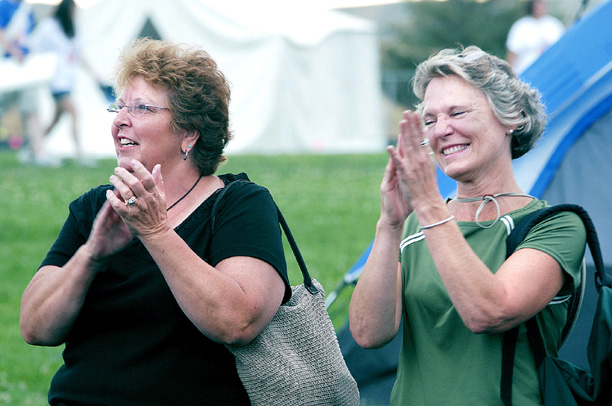 """Peggy Hough, left, and Linda Griffith cheer for survivors as they make their way around the track at Relay for Life on Friday. """"Every year, it's going to get bigger,"""" Griffith said about Craig's inaugural event."""