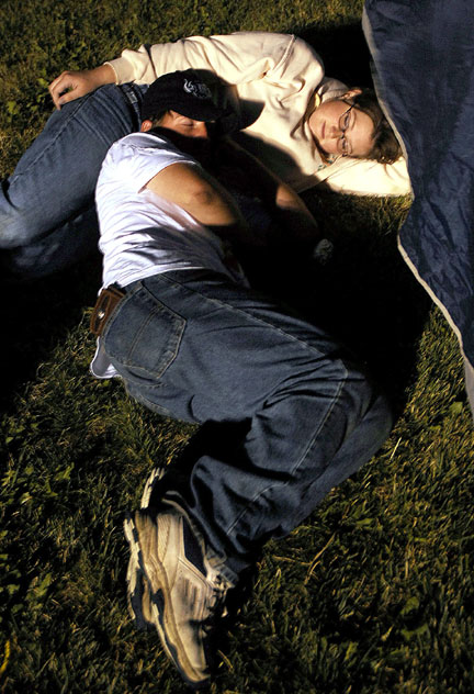 Rex Durham and Cassie Moon, both 18, try to catch a few winks of sleep at about 5 a.m. Saturday. However, master of ceremonies Ken Prescott kept most of Relay for Life's participants awake with loud, upbeat music.