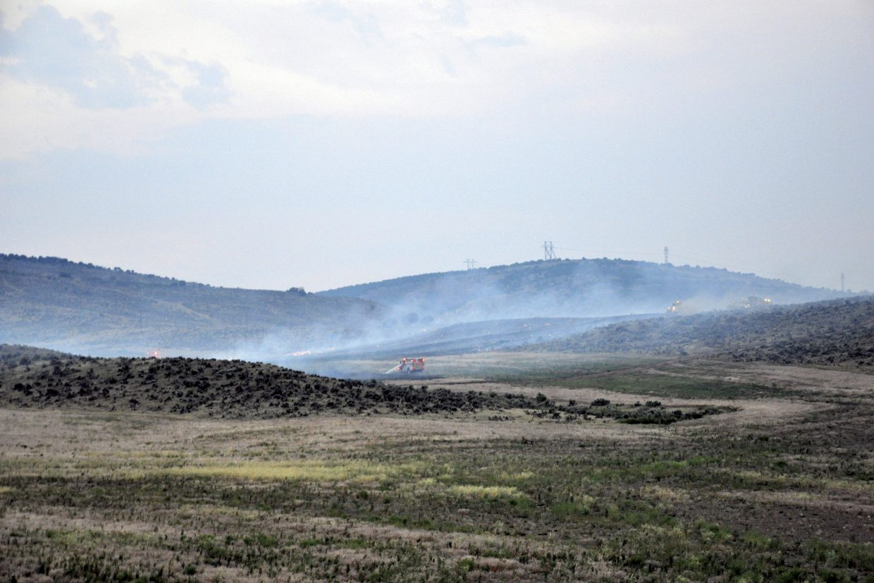 Firefighters battle a blaze Saturday night near Colowyo Coal Co. The fire was reported at about 7:45 p.m. and had scorched an estimated 80 acres by about 8:30 p.m. Officials reported it was fully contained late Saturday night.