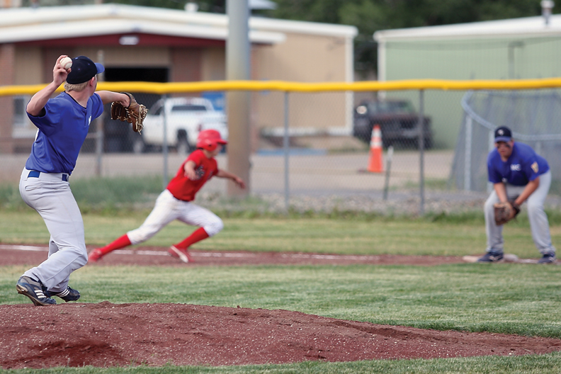 Bubba Ivers, left, tries to pick off a runner on first base during an American Legion league game against Steamboat Springs on Tuesday at Craig Middle School.