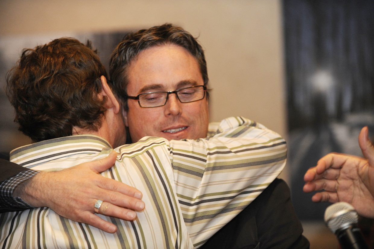 Danny Mulcahy gets a hug from his planner Peter Patton after learning that the Steamboat 700 annexation was voted down.