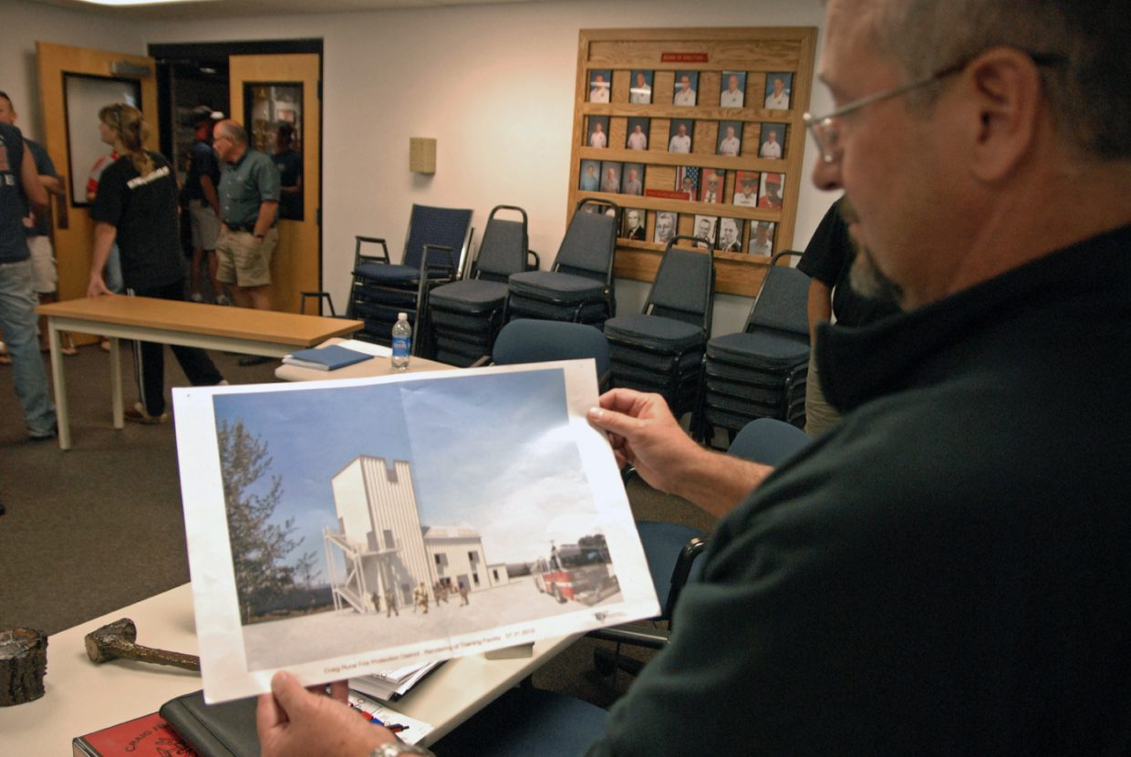 Craig Rural Fire Protection Board President Byron Willems examines a mock drawing of the live fire training tower slated for construction on Industrial Avenue behind Kmart.