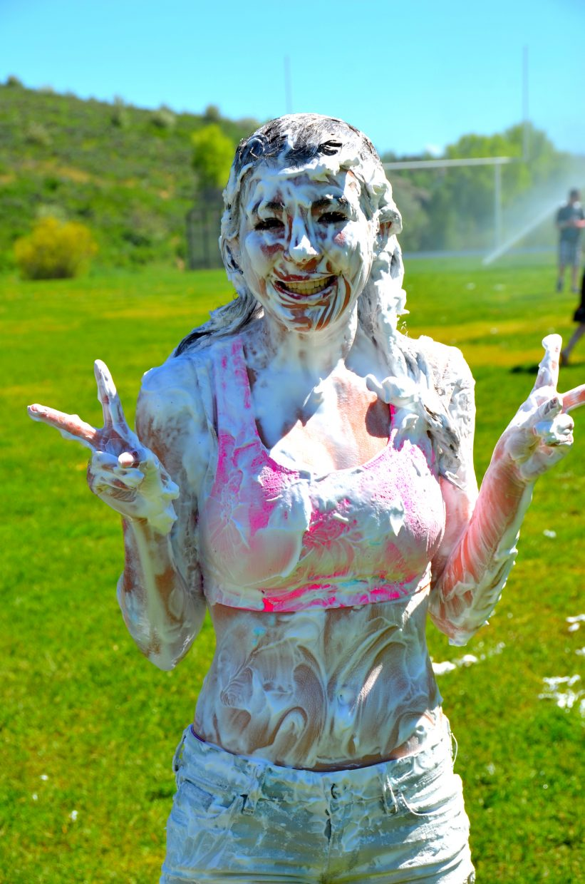 Eighth-graders at Steamboat Springs Middle School had a shaving cream party in the school field Wednesday, celebrating the last day of school. Pictured is Jessica Colombo. Submitted by: Shannon Lukens