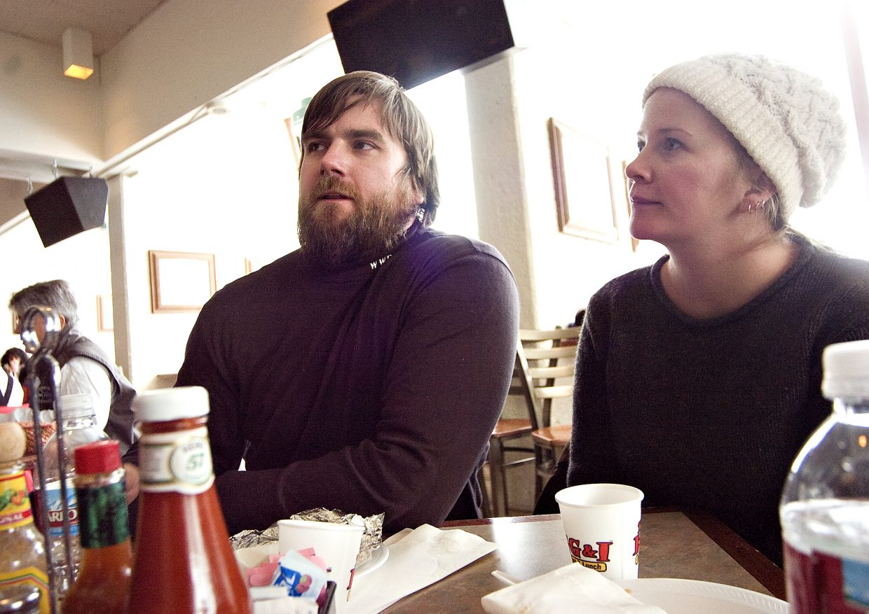 Adaptive skier Chris Fesmire, left, and his wife, Willow, chat with a reporter during breakfast at the Bear River Bar & Grill before hitting the slopes Saturday morning at the Steamboat Ski Area.