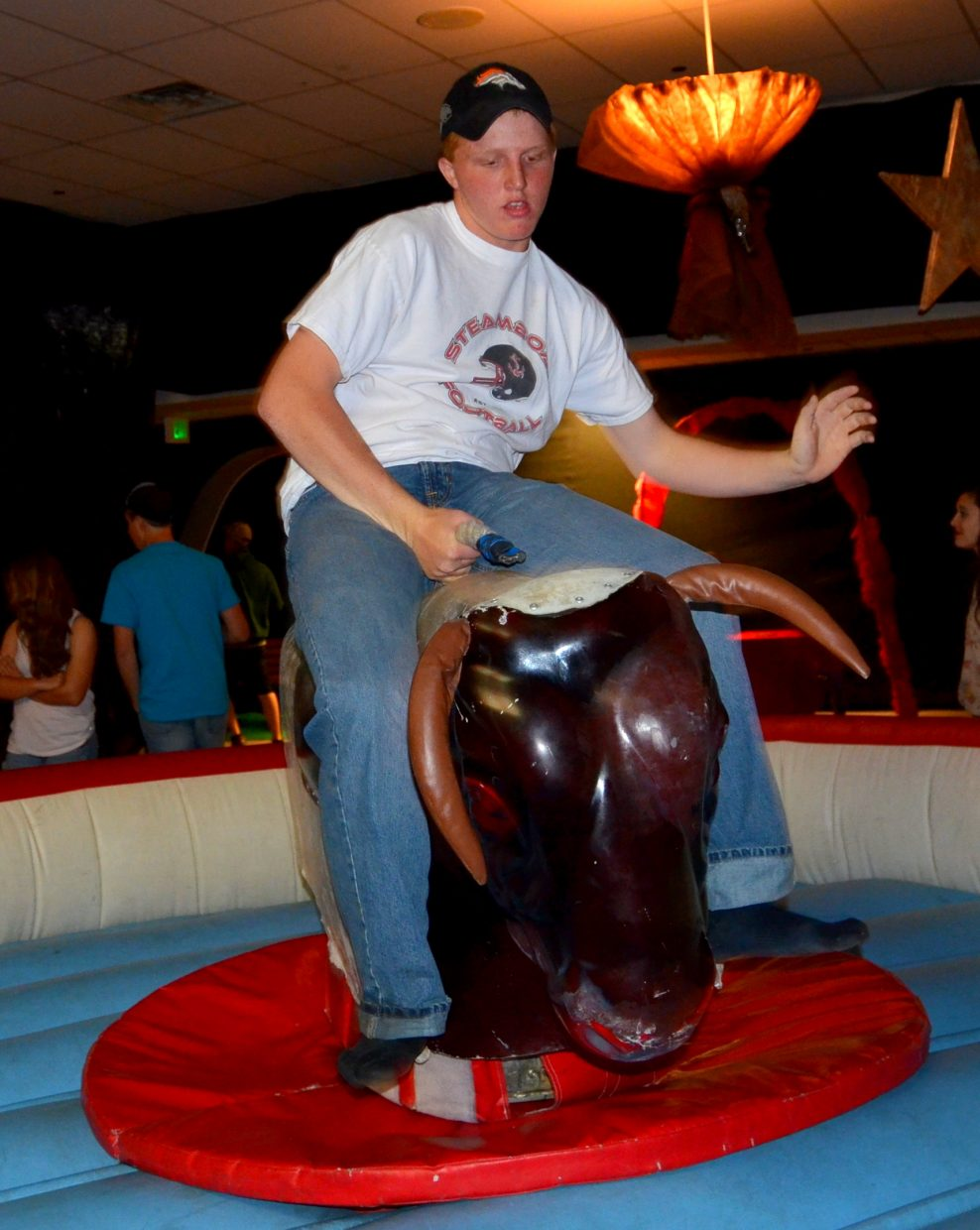 Brandon Yeager rides the bull at After Prom. The event was held starting at midnight Saturday at Steamboat Springs High School. Submitted by: Shannon Lukens