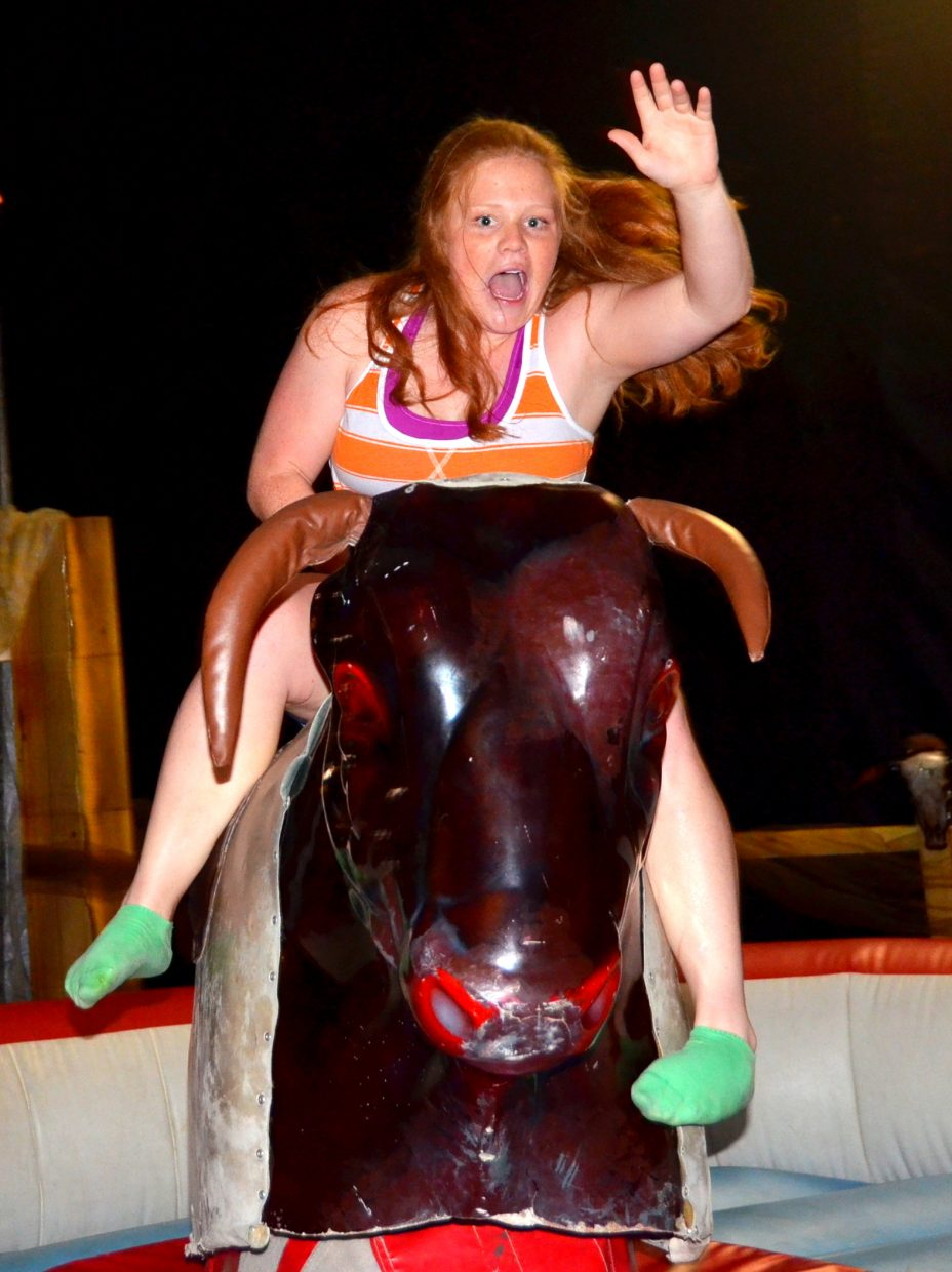 Hannah Samlowski rides the bull at After Prom on Saturday. Submitted by: Shannon Lukens