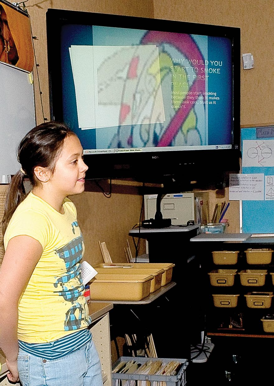 Fifth-grader Morgan gives an anti-smoking presentation to a class at Soda Creek Elementary School on Thursday, along with classmates Keala and Sierra.