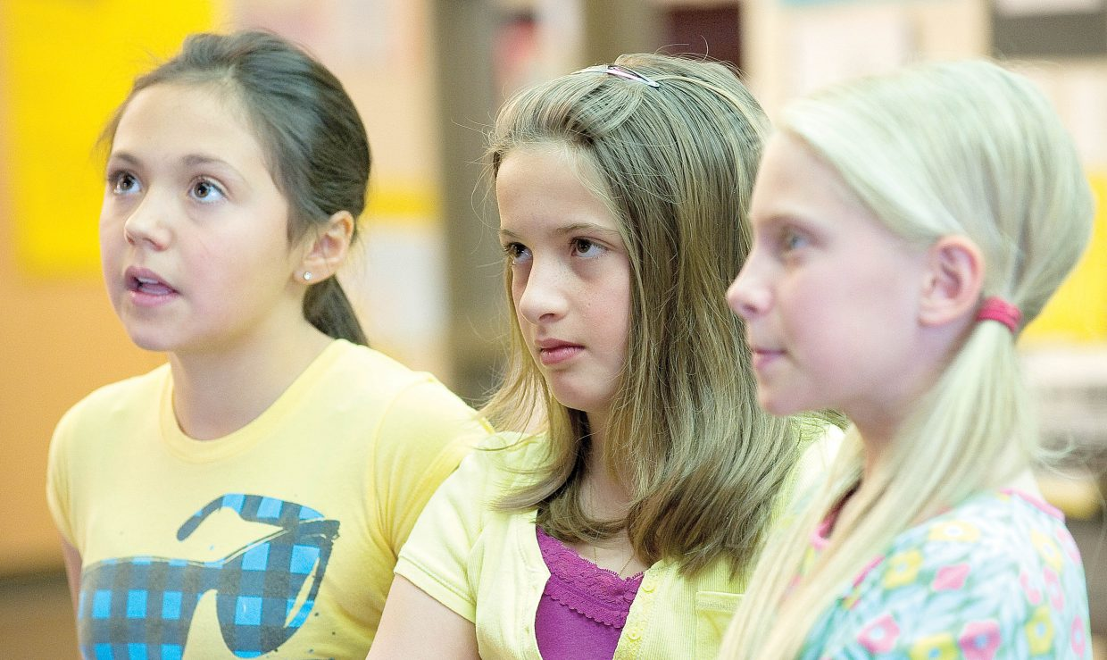 Fifth graders, from left, Morgan, Sierra and Keala talk about their anti-smoking presentation outside of class Thursday at Soda Creek Elementary School. The girls put together the presentation a few weeks after they participated in Tar Wars, a national tobacco-free education program for elementary school students.