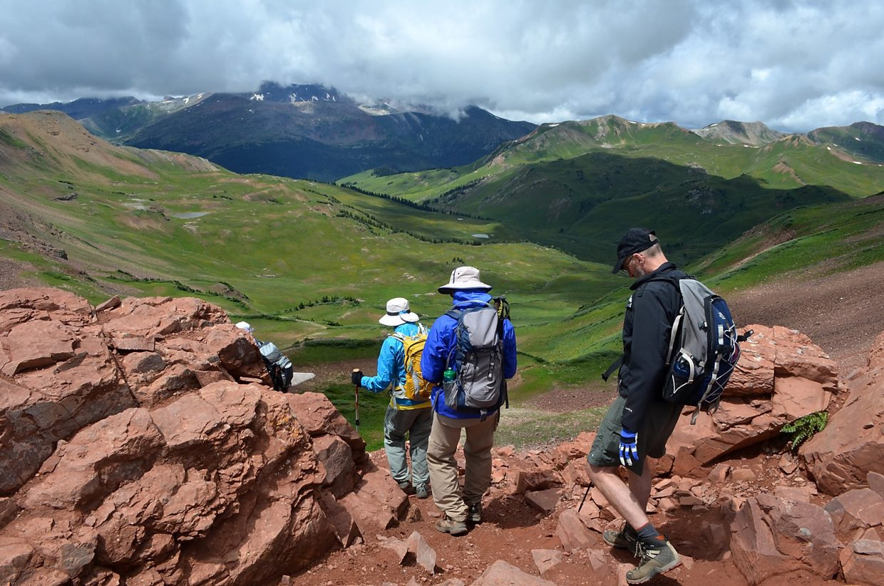 Hikers begin the descent of West Maroon Pass July 29 on their way from Aspen to Crested Butte.