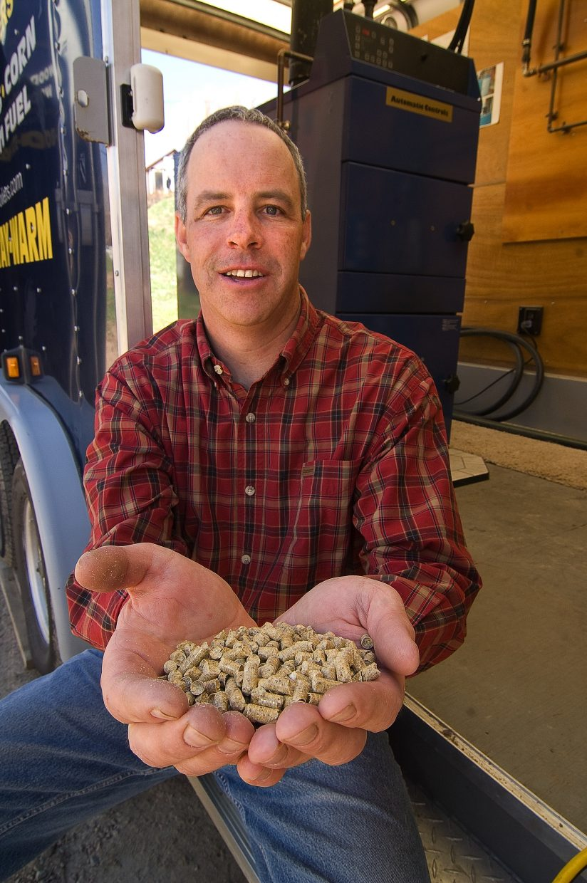 John Redmond holds the wood pellets used in the wood-pellet boilers he sells for Danish Company TARM USA. The pellets can be made from the scrap material that is created by many area saw mills that are busy processing trees killed by beetles.