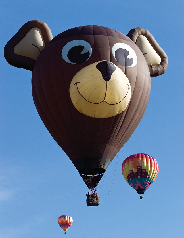 The Air Bear balloon, flown by Conrad Burgess and sponsored by Bank of the West sails over the Yampa Valley after taking off from Bald Eagle Lake near Steamboat Springs on Saturday morning during the 27th annual Hot Air Balloon Rodeo.