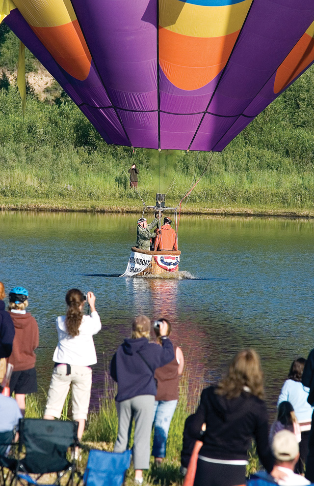 The Will O' The Wind balloon, piloted by Joe Lillard and sponsored by the Steamboat Grand Resort, skims across the surface of the lake shortly after taking off from Bald Eagle Lake near Steamboat Springs on Saturday morning during the 27th annual Hot Air Balloon Rodeo.