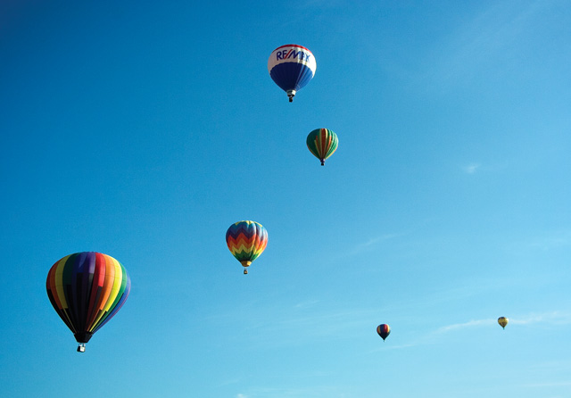 A group of hot air balloons float over the Yampa Valley after taking off from Bald Eagle Lake near Steamboat Springs on Saturday morning during the 27th annual Hot Air Balloon Rodeo.