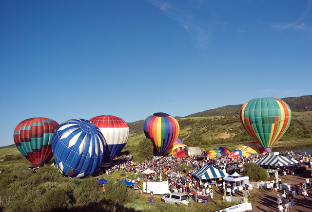 A group of hot air balloons inflate before taking off from Bald Eagle Lake near Steamboat Springs on Saturday morning during the 27th annual Hot Air Balloon Rodeo.