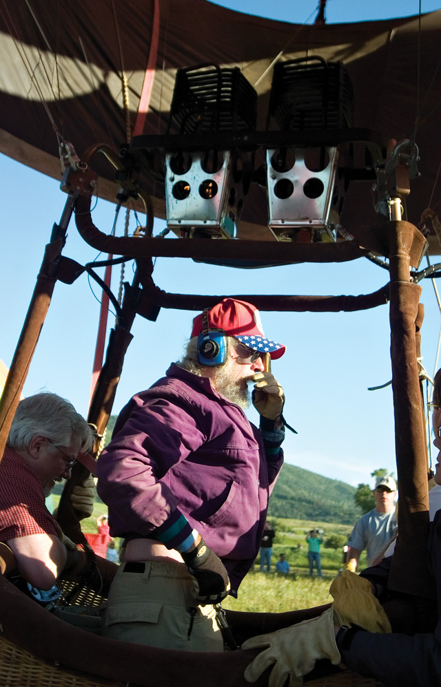 Hot air balloon pilot Dave Yob performs a radio check before taking off from Bald Eagle Lake near Steamboat Springs on Saturday morning during the 27th annual Hot Air Balloon Rodeo.