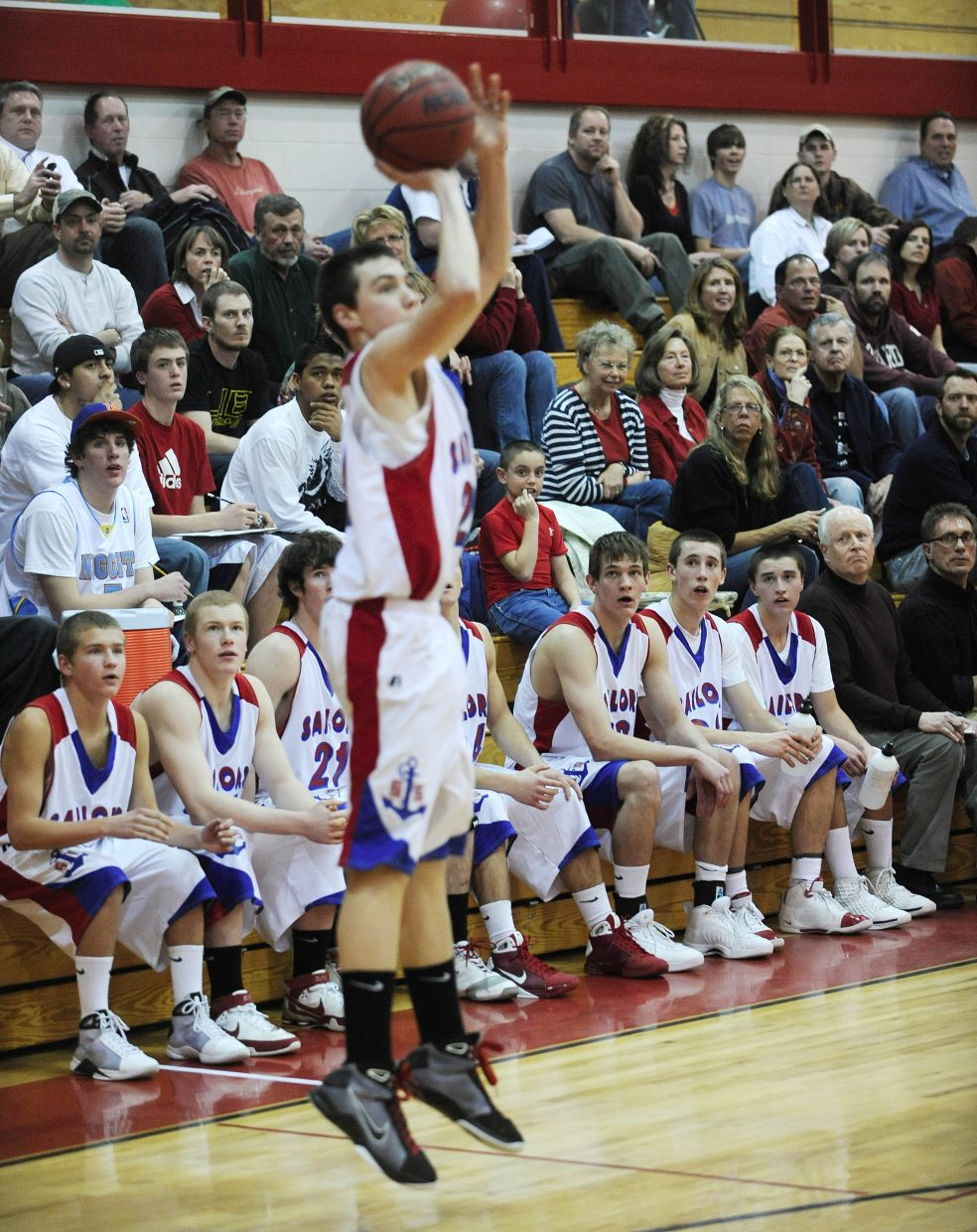 The Sailors bench watches sophomore Alan Capistron attempt a three during the second half.