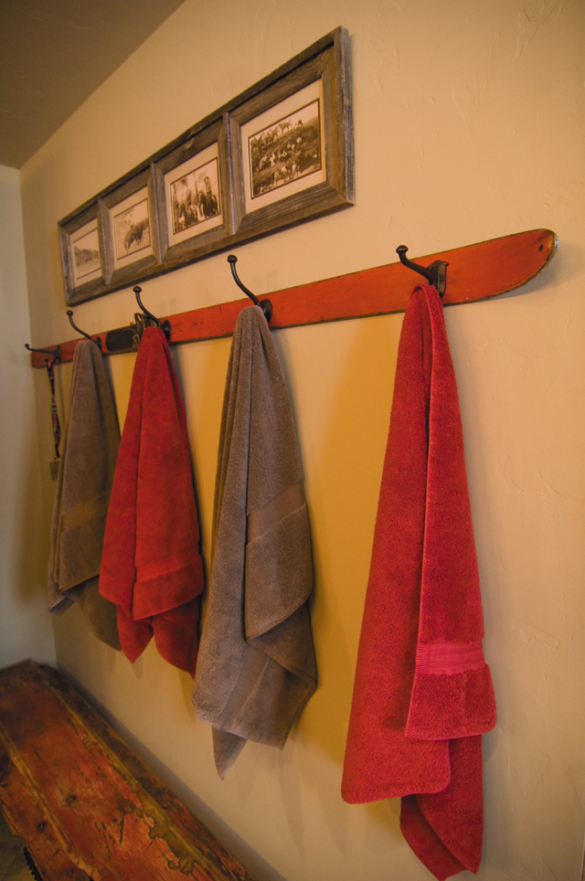 An old ski was crafted into a towel hanger for the bunkhouse bathroom, serving as a perfect reminder of Steamboat's rich skiing history. The humble piece helps make the large home feel cozy.